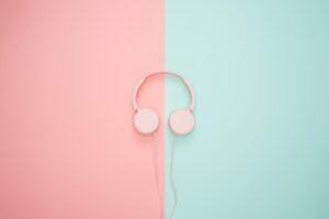 pink-corded-headphones-on-pink-and-teal-wall-1037996